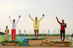 [L-R] Silver medalist Maja Wloszczowska of Poland, gold medalist Jenny Rissveds of Sweden and bronze medalist Catharine Pendrel of Canda celebrate on the podium during the Women's Cross-Country Mountain Bike Race on Day 15 of the Rio 2016 Olympic Games at the Mountain Bike Centre on August 20, 2016 in Rio de Janeiro, Brazil.