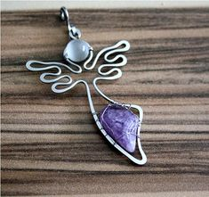 Length of pendant 6.3 cm    A single piece
