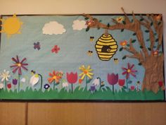 Spring bulletin board ~ love the bee hive.