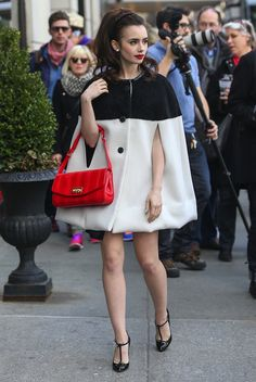 Lily Collins in an Emilio Pucci Pre-Fall 2013 Cape at Bergdorf Goodman (April 2013)