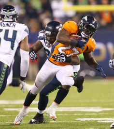 Denver Broncos running back Knowshon Moreno (27) carries the ball against the defense of the Seattle Seahawks during Super Bowl XLVIII at Metlife Stadium on Sunday, Feb. 2, 2014, in East Rutherford, N.J. (Todd Rosenberg/NFL)