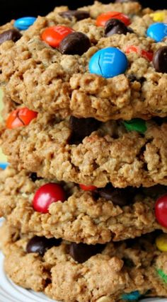 """Cookies The Best Monster Cookies Recipe """"A Peanut Butter- Oatmeal Cookie with Chocolate Chips and M&M Candies Mixed in.""""The Best Monster Cookies Recipe """"A Peanut Butter- Oatmeal Cookie with Chocolate Chips and M&M Candies Mixed in. The Best Monster Cookie Recipe, Cookie Monster, Monster Cookie Recipes, Pioneer Woman Monster Cookies Recipe, No Flour Monster Cookies Recipe, Soft Monster Cookies, Pioneer Woman Cookies, Recipe Monster, Yummy Treats"""