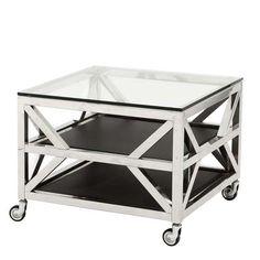 Der EICHHOLTZ ® Side Table / Beistelltisch Prado schöpft aus dem Vollen. Äußerst stabile Ausführung in Edelstahl, sehr stark dimensionierte Streben, große Industrierollen und eine dicke Glasplatte vermitteln eine massive Impression....