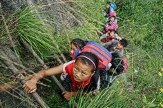 A village in China's mountainous west where schoolchildren must climb an 800-meter (2,625-foot)-high... - Provided by Associated Press
