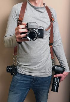 fc32a68d14d6452a39db9f20f028c221 canon cameras nikon inspired by gun holsters, the moneymaker is a leather harness that dual camera harness at fashall.co