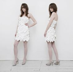theLIVLAVone mini dress, made of multiple pieces of heart-shaped extra soft, bright white vegan leather.