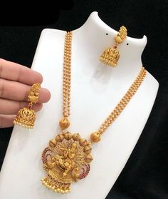 Temple jewellery available at AnkhJewels for booking WhatsApp on Gold Chain Design, Gold Bangles Design, Jewelry Design, Pearl Necklace Designs, Antique Necklace, Gold Mangalsutra Designs, Indian Jewelry Sets, Gold Jewelry Simple, Temple Jewellery