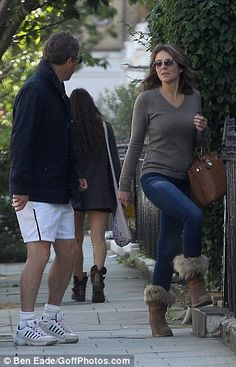 Hugh Grant can't keep his eyes to himself on walk with ex Liz Hurley