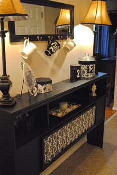 bookcase headboard turned into a usable entryway table. SO clever!  I see these ALL of the time in thrift stores!!