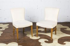 "A pretty pair of dining chairs with tapered angular legs by Brown Saltman. It's not easy to find an upholstered dining chair candidate that has the petite proportions of a  wooden chair. These would be perfect in a striking textile at the head and foot of a dining table.    20"" wide x 33"" high x 20"" deep   seat height: 17""   inside seat depth: 17.5""    $625.00 to purchase the pair as shown   $375.00 each to reupholster   5 yards needed, total"