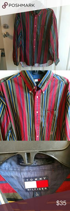 Tommy Hilfiger men's red striped long sleeve shirt Tommy Hilfiger men's red, green blue striped long sleeve button down shirt. Size large. Gently used with no flaws.  B9-132 Tommy Hilfiger Shirts Casual Button Down Shirts