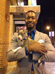 Philadelphia Phillies Domonic Brown with his adopted puppy, Wreck