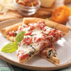 Pizza Margherita Recipe from Taste of Home  So delicious!  The seasoning we use is 2 t. each dried oregano and basil, then the red pepper, salt and pepper called for.  We prefer to use Jack cheese which stays creamier and easier to eat than Mozzarella.