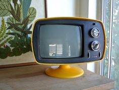 It would match the kitchen. 1960s Space Age MOD Philco Portable Tulip Base by DuchessVintage, $350.00