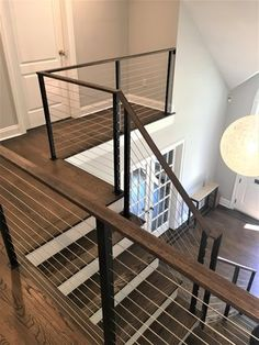 Contemporary stair cable railing Modern Staircase Railing, Cable Stair Railing, Stair Railing Design, Interior Staircase, Railing Ideas, Modern Railings For Stairs, Entryway Stairs, Staircase Ideas, Staircases