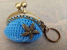 Llavero-monedero azul con estrella de mar (color bronce)