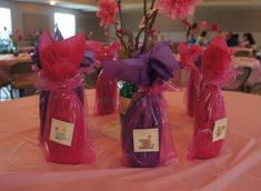 Baby Shower Guest Prizes: Lotion wrapped in tissue and a clear favor bag with a personalized sticker.