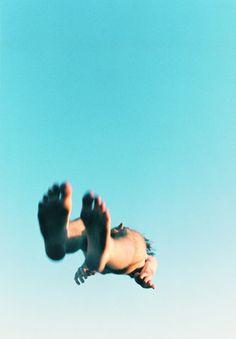 Ryan McGinley falling person blue sky