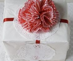 """White tissue, muffin wrapper flower, """"snowflake"""" doilies and red ribbon - Songbird Christmas White Red Gift Wrapping 2 Creative Christmas Gifts, Christmas Gift Wrapping, Simple Christmas, Christmas Diy, Christmas Presents, Creative Gift Wrapping, Wrapping Ideas, Wrapping Presents, Gift Bows"""