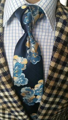 Like the floral blue necktie but NOT with this jacket www.thecorvancollection