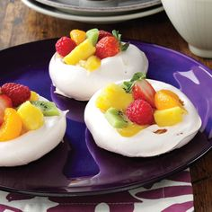 """Easter Meringue Cups Recipe -These crunchy meringue shells with a lemon curd filling will make guests stop to """"ooh"""" and """"ahh"""" at your dessert table. Topped with fresh fruit, they're especially pretty when served with a spring meal. —Taste of Home Test Kitchen"""