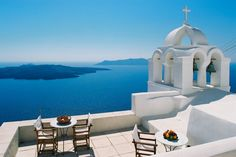 7. what can be bluer than the #blue hues of #Santorini in Greece?  Those winding roads beckoning Vespa FLORENCE to #ridecolorfully - onwards and upwards