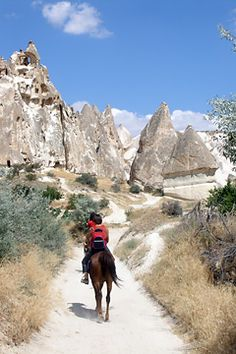 "Horseback riding in Cappadocia - Cappadocia known as the ""Land of Beautiful Horses"" is the ideal place to explore on horseback. The trail winds through volcanic stone hills passing beautiful fairy chimneys and churches along the way with breathtaking vistas and unique landscapes in every direction."