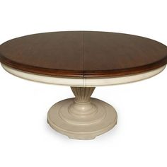 This traditional distressed linen finished table with a chestnut top and urn shaped pedestal is sure to add class and character to your dining space.