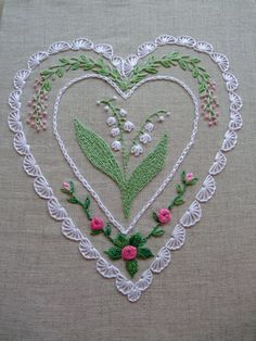 Coeur broderie traditionnelle. Beautiful! Lily of the Valley and heart embroidery.