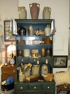Another of our booth displays in antique mall - crocks in step-back hutch