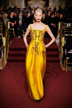 """Glowing yellow silk from Zac Posen is briliantly emboidered on a structured bodice. The lacy pattern drips to a gathered waist. From the selections by Refinery 29, """"The 16 Prettiest Dresses From Fashion Week"""" in New York. I'm passionate for yellow this spring!"""