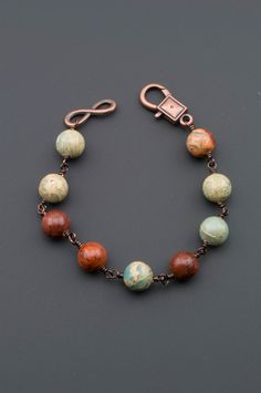 Absolutely gorgeous African Opals in colors ranging from creams and tans to aqua to deep sienna. Each gemstone in this bracelet is individually wire wrapped to the next, for superior strength that wil