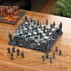Black Dragon Chess Set from Koehlerhomedecor.com - Fire-breathing beasts battle for supremacy above the charred remains of dragon warriors that perished in this never-ending battle. Perched atop four corners of the kingdom, these winged monsters will not rest until they strategically best their opponent. A thrilling and visually stunning way to enjoy a rousing game of chess. Buy wholesale at Koehler Home Décor.
