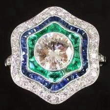 Art Deco platinum engagement ring with diamonds, sapphires and emeralds