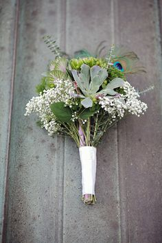 love peacock feathers in a green bouquet (no allergies!)