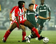 Yaya Touré, Olympiacos FC (2005–2006, 26 apps, 3 goals). Argentinian midfielder Ezequiel Gonzalez (Panathinaikos FC), right, challenges for the ball with Yaya Touré from Ivory Coast during their Greek 1st division match in Athens' Olympic stadium on 28 August 2005.