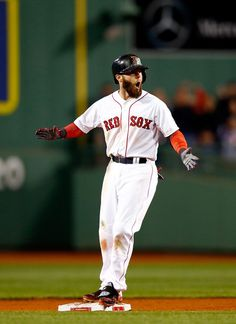 Dustin Pedroia #15 of the Boston Red Sox reacts after hitting an RBI double in the sixth inning againstthe Detroit Tigers during Game 2 of the ALCS at Fenway on Oct. 13, 2013.