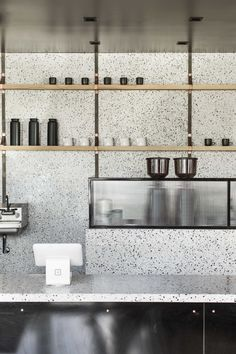 Throughout the cafe, walls are sheathed in ash and ceilings are covered with acoustic panels. The concrete floor is original to the building and has been highly polished. Cafe Bar, Cafe Restaurant, Restaurant Design, Modern Restaurant, Terrazzo, Cafe Interior Design, Kitchen Interior, Kitchen Design, Design Café