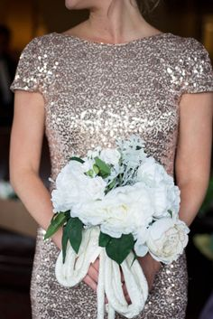 Sparkly rose gold bridesmaid dress and white bouquet
