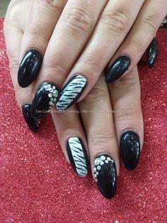 Black gel polish with freehand nail art and swarovski crystals