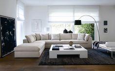Salotto contemporaneo con arredi in bianco e nero ed un quadro astratto degli stessi colori come decorazione - Design soggiorni contemporanei