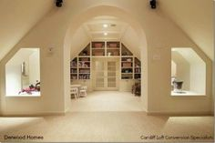 Cardiff Loft Conversion Specialists bookcase wall around the door