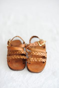 "$25 (4"" - 5.5"") handmade leather sandles; profits go to fair trade type support! This is actually a really cool site."