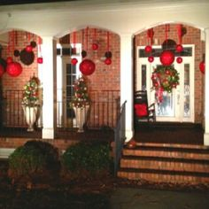 Outdoor Christmas Decorating Ideas Large Ornaments Hanging From Ribbon