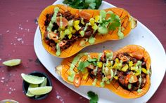 This healthier take on tacos involves filling a roasted butternut squash with homemade refried black beans, fresh veggies, and a magical green avocado dressing.