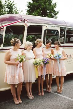 Bridesmaids in short pink dresses from Warehouse and carrying different colour bouquets. From 'David Fielden, Wheatfields and A Charming Rustic Barn Setting ~ The Pretty Summertime Wedding of Emma and Jordan' http://www.daniellebenbow.co.uk/