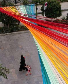 EOT design studio creates colorful, whispering rainbow in tehran