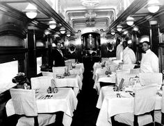 Early image inside the dining car with the Steward and the wait staff.