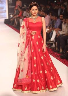 Beautiful -https://www.cooliyo.com/product/100510/art-silk-machine-work-red-semi-stitched-long-anarkali-suit/
