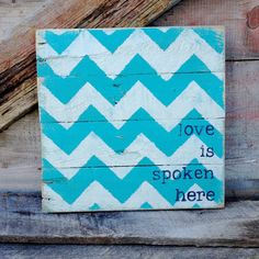 Shabby chic chevron sign made out of pallets. Hand painted in turquoise aqua, white and black.